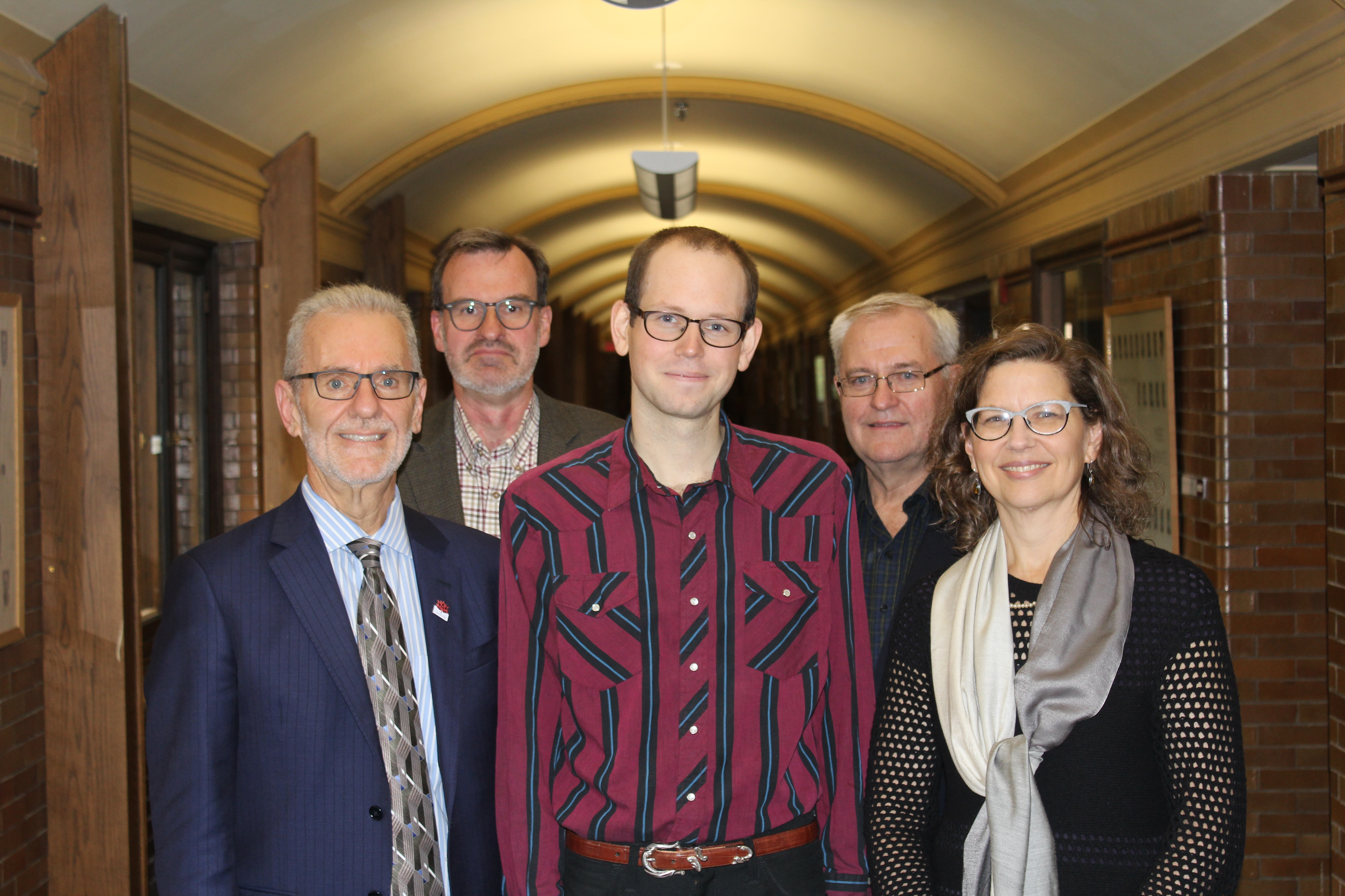 CMU donor Ted Fransen stands with Joshua Nightingale and CMU represenatives.
