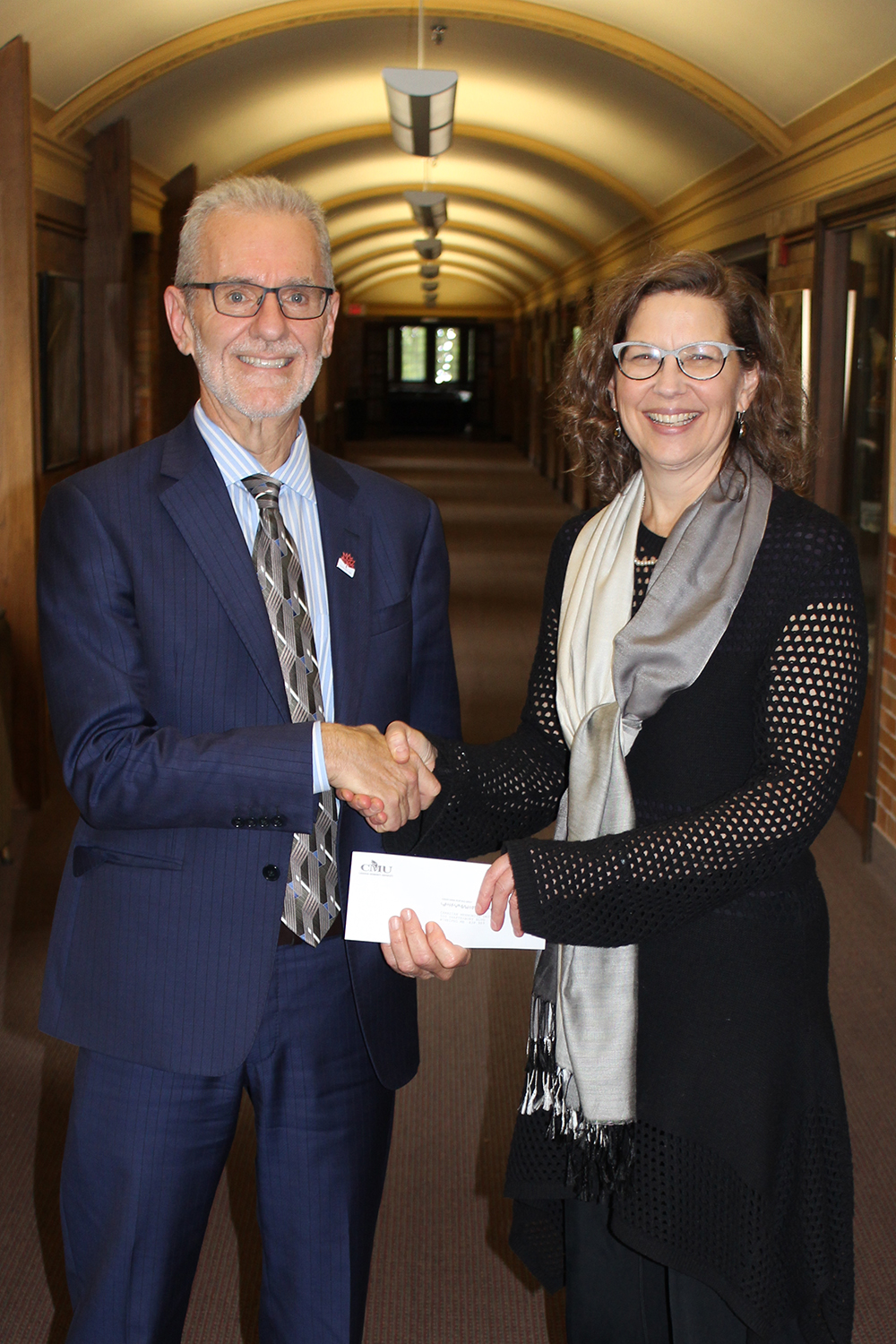 Ted Fransen presents a cheque to CMU President Dr. Cheryl Pauls