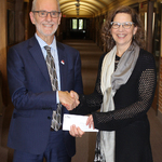 Ted Fransen presents a cheque to CMU President Dr. Cheryl Pauls, bringing the endowment for the Jacob A. Rempel Memorial Scholarship to $100,000. Fransen is one of Rempel's grandsons.